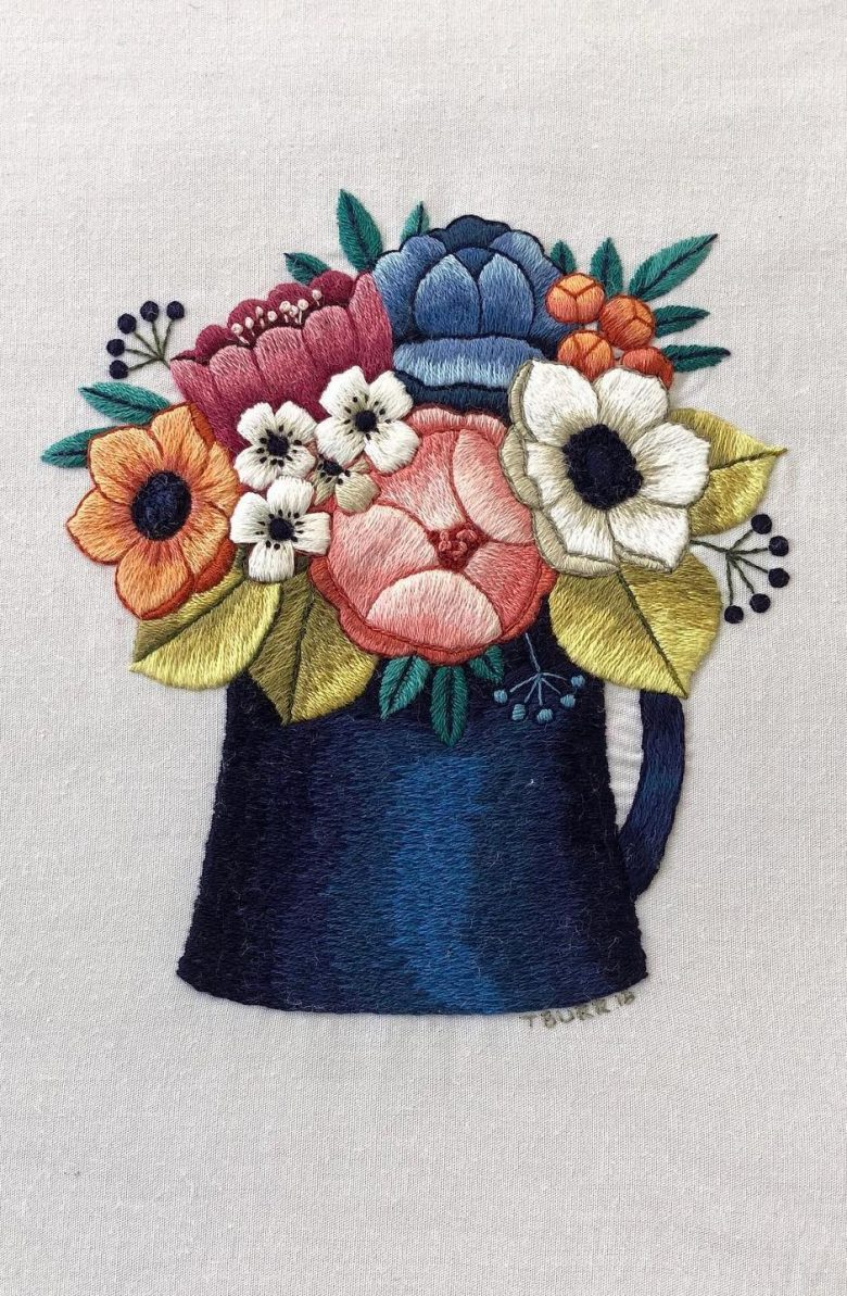 love this jug of flowers embroidery design by trish burr - which you can buy as a PDF pattern download. Just one of the exquisite flower embroidery DIY project ideas I've shared - hope you find something to inspire you #embroidery #flowers #diy #patterns #tutorials