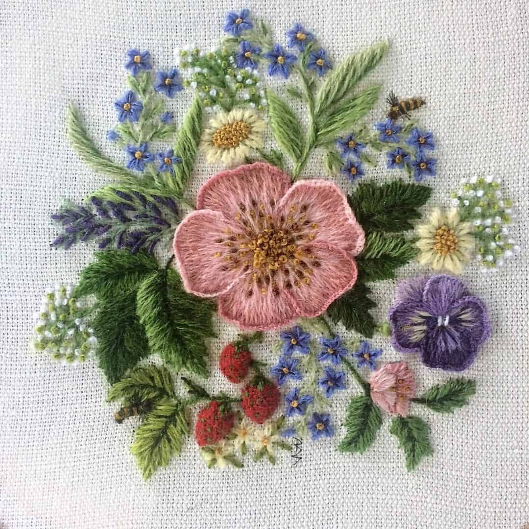 crewel embroidery kit wild english garden flowers dog rose, lavender, pansy, forget me nots, wild strawberries available to buy as a DIY kit from Etsy just one of the beautiful ideas I've shared with links to everything you need to enjoy crewel embroidery #crewel #embroidery #diy #kits #etsy