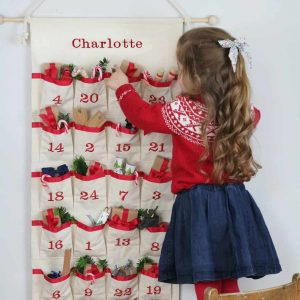 personalised natural unbleached cotton fabric advent calendar with embroidered pockets ready to fill with little presents