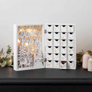 storybook illuminated advent calendar with drawers to fill with treats in white wood with winter woodland carved scene
