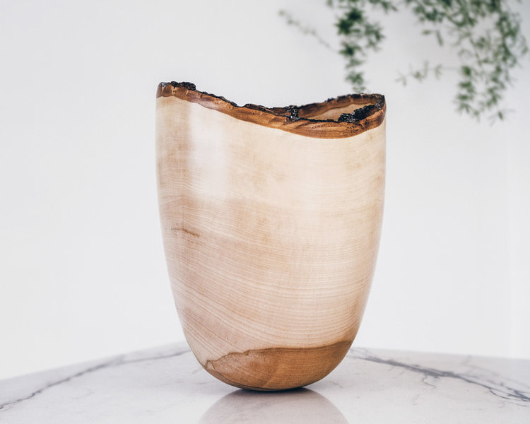wooden and woven vessel